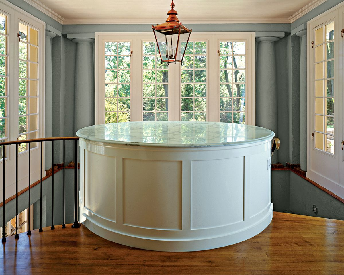<p><strong>In the Round</strong><br> Located on a staircase landing between two floors, this cylindrical powder room serves as the intriguing architectural centerpiece of the grand staircase in a formal home designed by architect McKee Patterson. The marble console sink—on view when you push open the curved door—sits along the same wall as the commode in the 22-square-foot space.</p>
