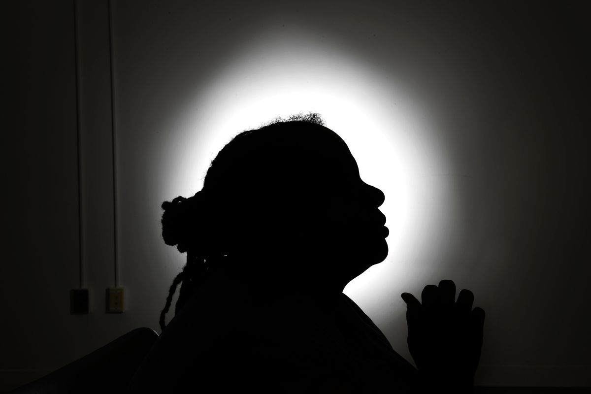 A woman's profiled silhouette.