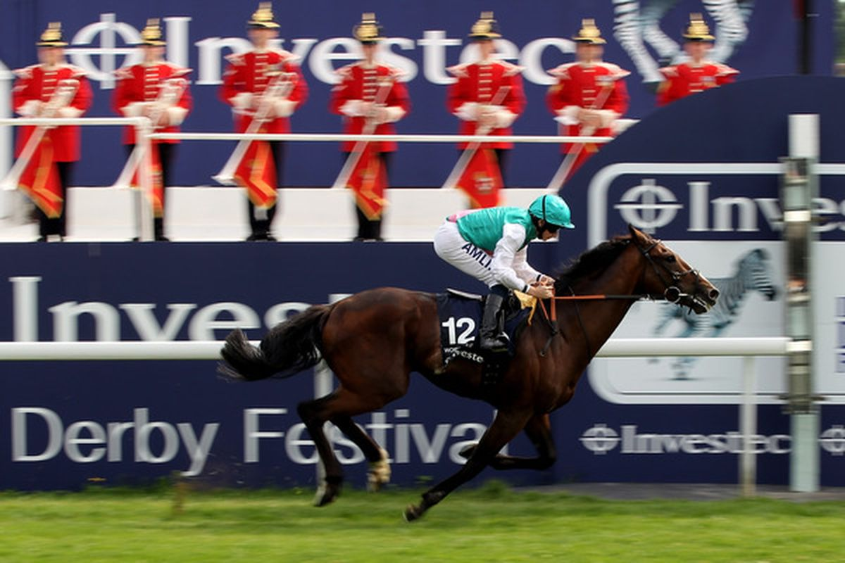 EPSOM, ENGLAND - JUNE 05: Workforce ridden by Ryan Moore leads the field to win The Investec Derby during the Investec Derby Festival at Epsom Racecourse on June 5, 2010 in Epsom, England.  (Photo by John Gichigi/Getty Images)