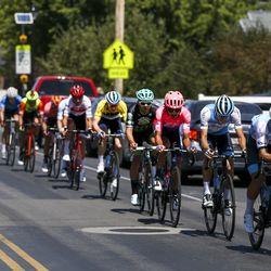 The peloton rides through a neighborhood during Stage 3 of the Tour of Utah near Syracuse on Thursday, Aug. 15, 2019.