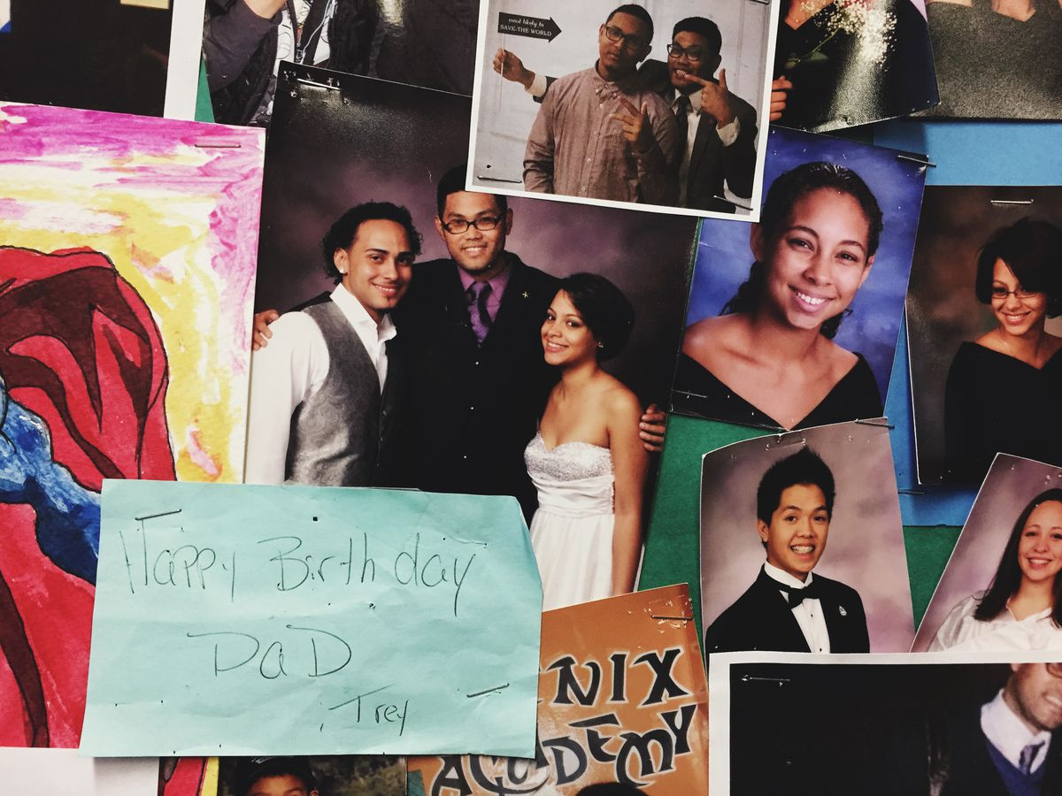 Principal Manalo's office walls are covered with pictures and notes from his students