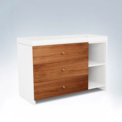 """Duc Duc's 3-drawer <a href=""""http://www.ducducnyc.com/productdetail.php?productid=237&categoryid=61&navid=1"""">changing table</a> ($1545) is simple and sophisticated, like the crib. If this seems too boring for Bey, it also comes in six other colors."""