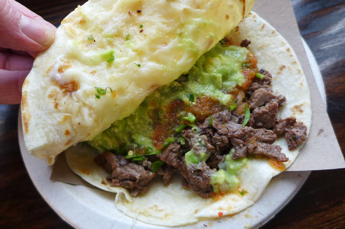 A flour gringa, like a quesadilla with cheese and grilled beef inside.
