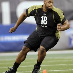 FOR USE AS DESIRED WITH NFL DRAFT STORIES - FILE - In this Feb. 25, 2012, file photo, Georgia offensive lineman Cordy Glenn runs a drill at the NFL football scouting combine in Indianapolis. Glenn is a top prospect in the upcoming NFL football draft. AP Photo/Michael Conroy, File)