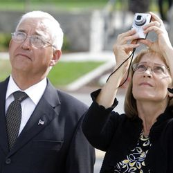 Alan and Brenda Godfrey take a photo of the temple after the first dedicatory session at the Brigham City Temple Sunday, Sept. 23, 2012.