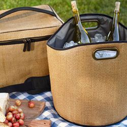 """Sometimes you just need more than one bottle of wine. <b>Pottery Barn</b> Party Bucket, <a href=""""http://www.potterybarn.com/products/dillon-drink-coolers/?pkey=cpool-beach&"""">$39</a>"""