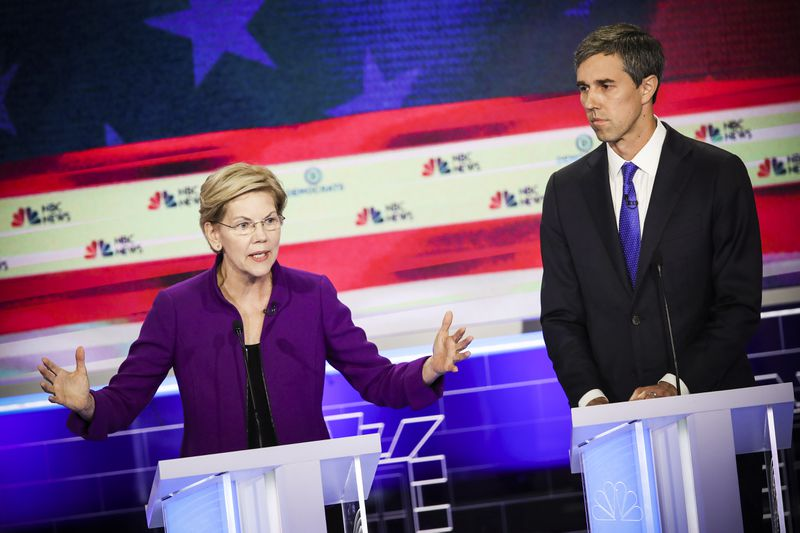 Sen. Elizabeth Warren (D-MA) speaks as former Texas congressman Beto O'Rourke looks on during the first night of the Democratic presidential debate on June 26, 2019 in Miami, Florida.