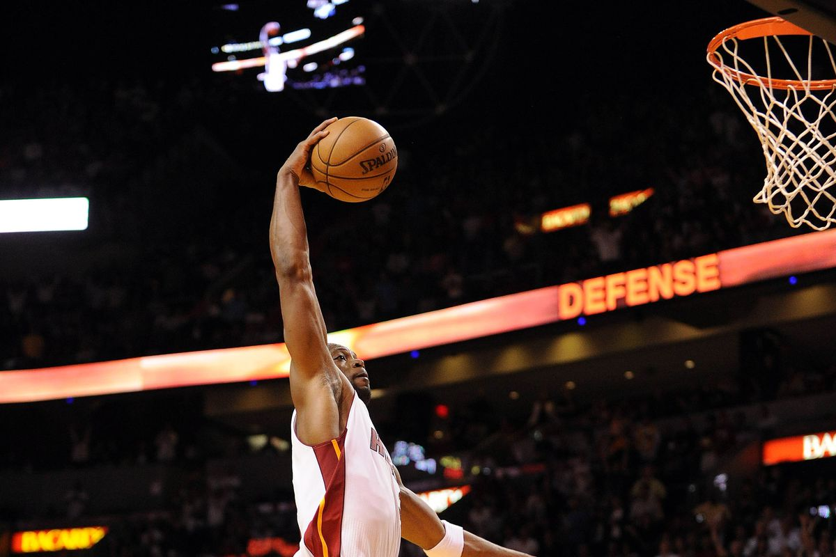 Wade rises for a dunk in overtime.