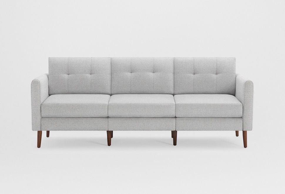 A gray three-seat sofa with wooden legs.