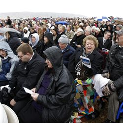 The crowd sings the opening hymn while sitting in the rain Saturday, Oct. 8, 2011 for the ground breaking for the Payson Temple.