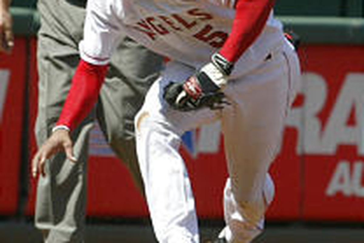 Former Salt Lake Stinger Alfredo Amezaga fields a ball for the Angels during their loss to Oakland.