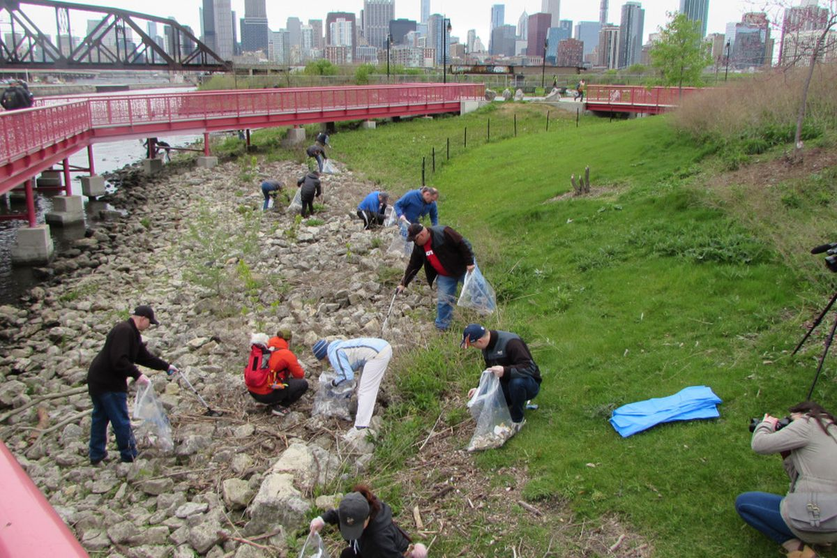 On Chicago River Day, volunteers conduct cleanup of litter along the river in Ping Tom Park in Chinatown on May 11, 2019.