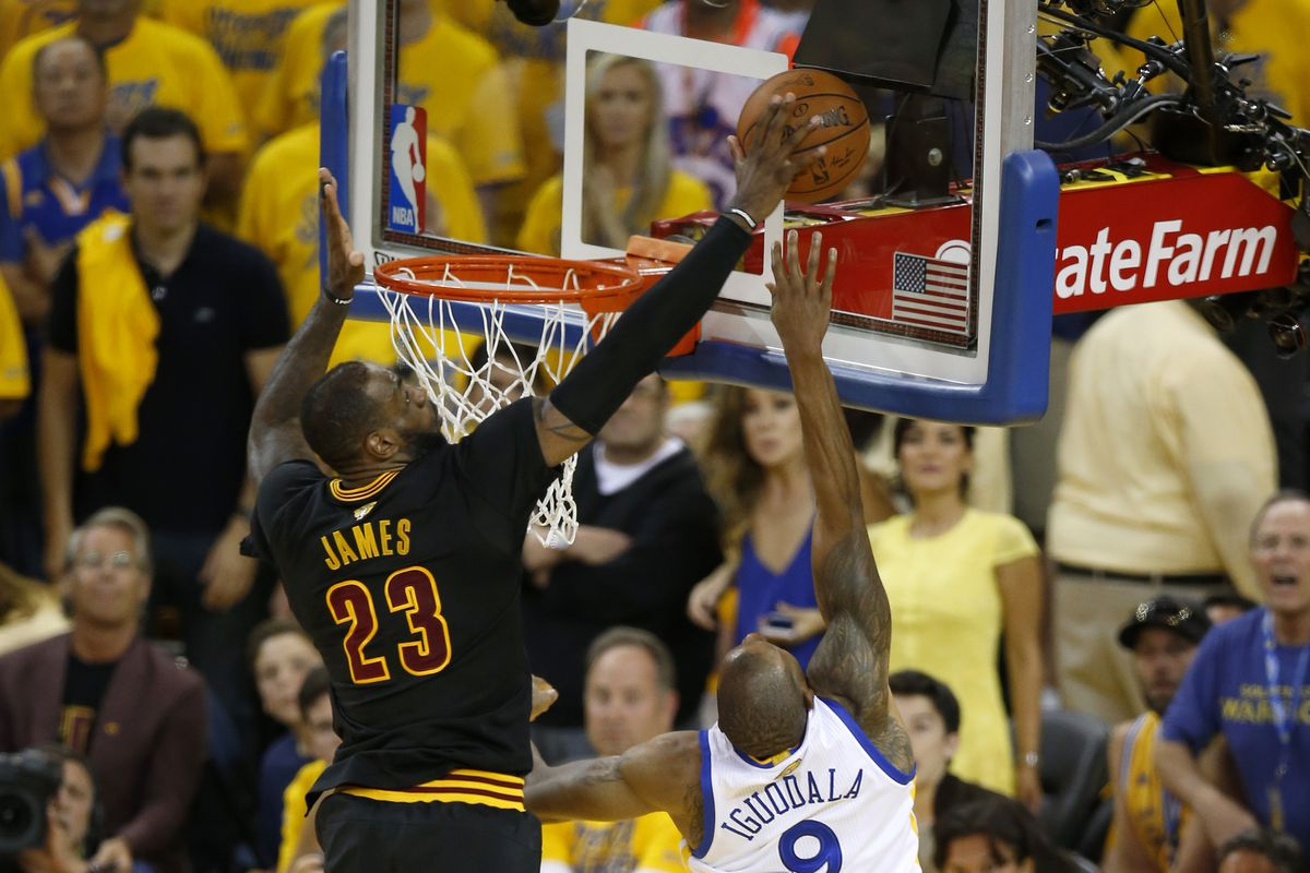 Cleveland Cavaliers' LeBron James (23) blocks a shot against Golden State Warriors' Andre Iguodala (9) in the fourth quarter of Game 7 of the NBA Finals at Oracle Arena in Oakland, Calif., on Sunday, June 19, 2016. (Nhat V. Meyer/Bay Area News Group)