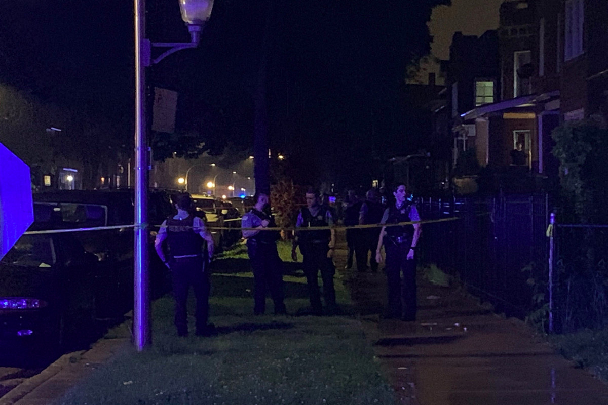 Chicago police investigate a shooting Saturday night in Austin that left a 13-year-old girl struck by a stray bullet in critical condition and two teenage boys also wounded.