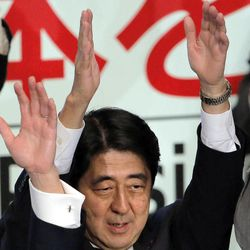 Former Prime Minister Shinzo Abe celebrates after winning his party leader election of Japan's opposition Liberal Democratic Party in Tokyo, Wednesday, Sept. 26, 2012.  Abe, known as a hawk and nationalist, won the election Wednesday to become president of the main opposition Liberal Democratic Party.