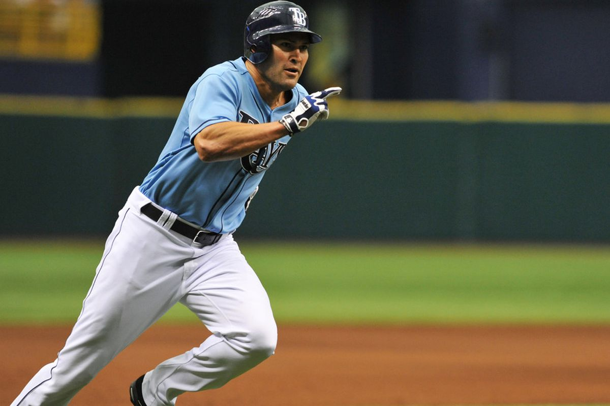 Johnny Damon rounds third base against the St. Louis Cardinals at Tropicana Field in St. Petersburg, Florida. (Photo by Al Messerschmidt/Getty Images)