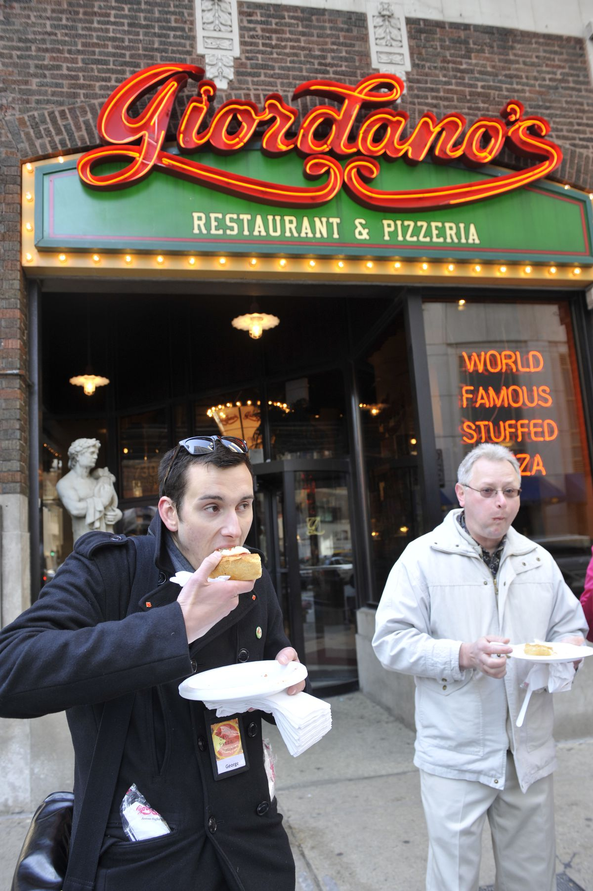 """Maebe A. Girl, left, the former George Pudlo, grew up in the Chicago area, where she ran """"Second City Pizza Tours,"""" seen here back in 2010."""