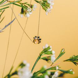 "Mociun sunstone and black diamond crescent necklace, <a href=""http://store.mociun.com/jewelry/necklaces/#!/636-sunstone-and-black-diamond-crescent-necklace/"">$828</a>; Stems Brooklyn 'Sweet Something' arrangement, <a href=""http://stemsbrooklyn.com/bouquet"