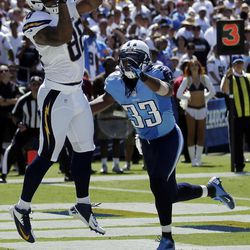 San Diego Chargers tight end Dante Rosario, left, makes a touchdown catch as Tennessee Titans free safety Michael Griffin looks on during the first quarter of an NFL football game on Sunday, Sept. 16, 2012, in San Diego.
