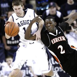 Utah State's Preston Medlin, left, grabs a loose ball in front of Mercer's Travis Smith (2) in the Aggies' loss.