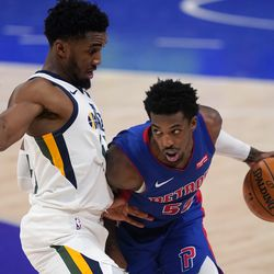 Detroit Pistons guard Delon Wright (55) drives on Utah Jazz guard Donovan Mitchell (45) during the second half of an NBA basketball game, Sunday, Jan. 10, 2021, in Detroit.