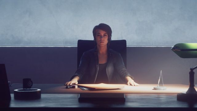 Jesse from Control sits at a desk in the trailer for the game's Ultimate Edition