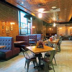 Owner Rahul Marwah says he wanted this Denny's to feel like a regular New York restaurant. Hence: exposed brick, tin ceiling, and leather booths.