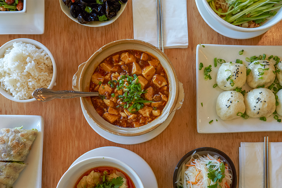 An overhead photo of mapo tofu and other Taiwanese dishes.