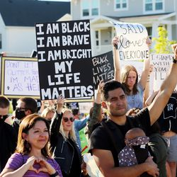 Several hundred demonstrators gather for Black Lives Matter near an art piece by artist Nathan Brimhall, entitled TEACH, at Daybreak in South Jordan on Wednesday, June 17, 2020.