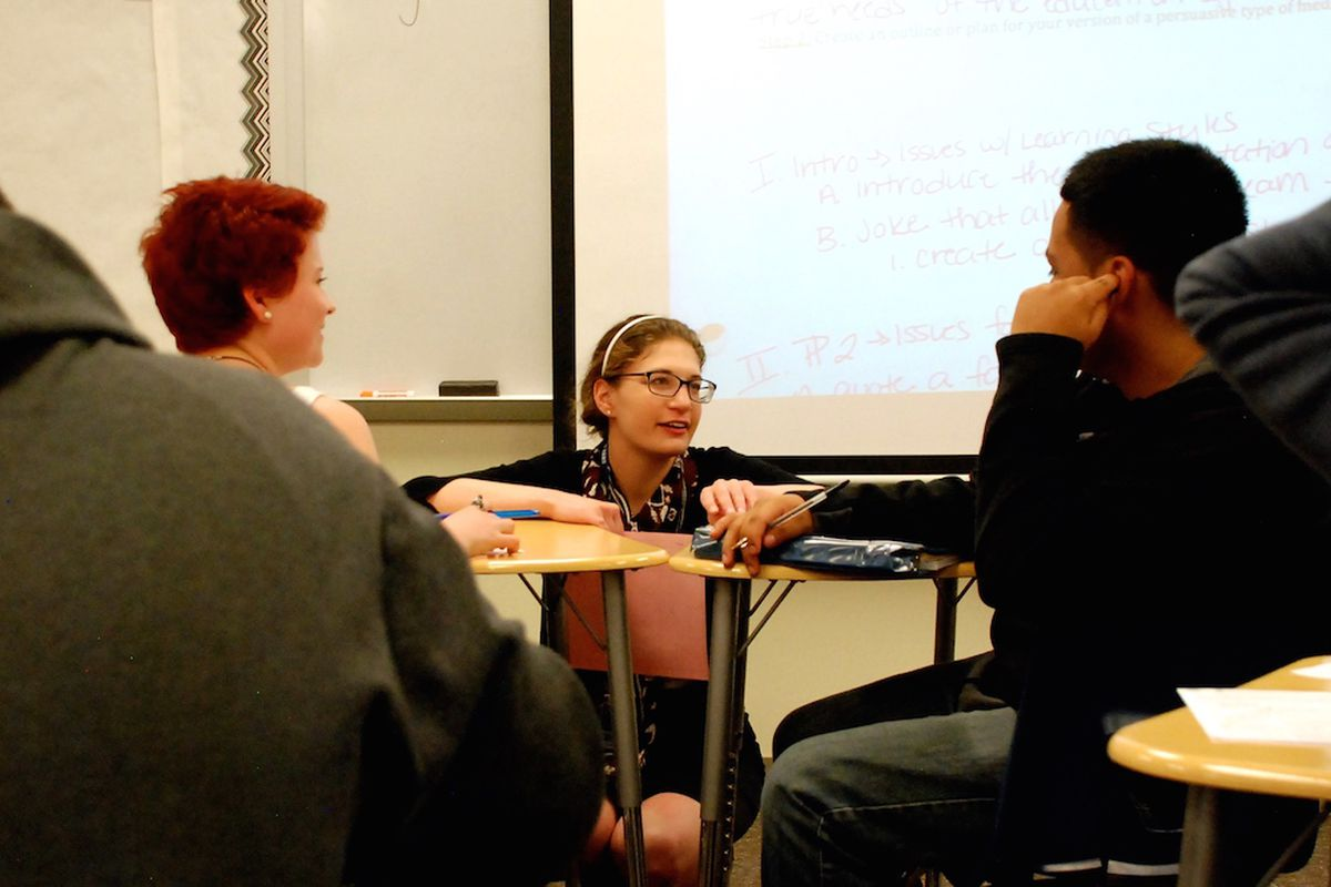 Sheridan High School English teacher Molly Gold, center, meets with students during class time.