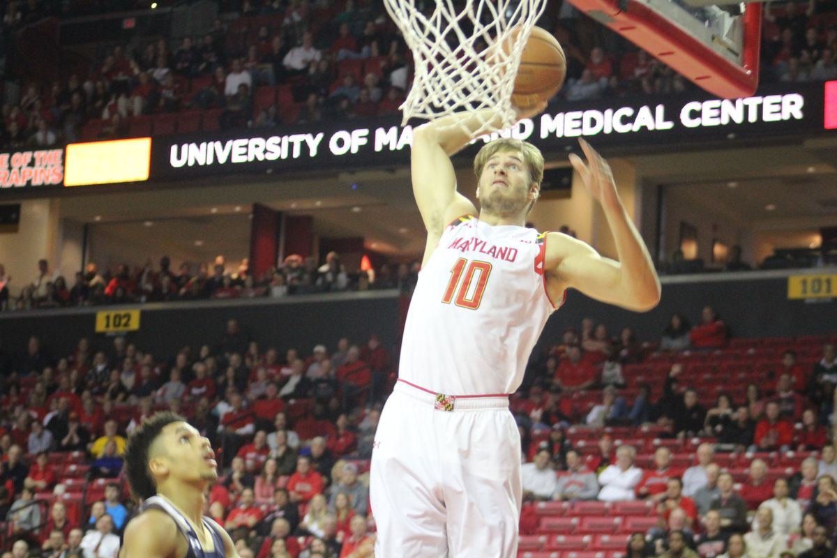 Maryland forward Jake Layman dunks during the first half of Friday's game against Mount St. Mary's.