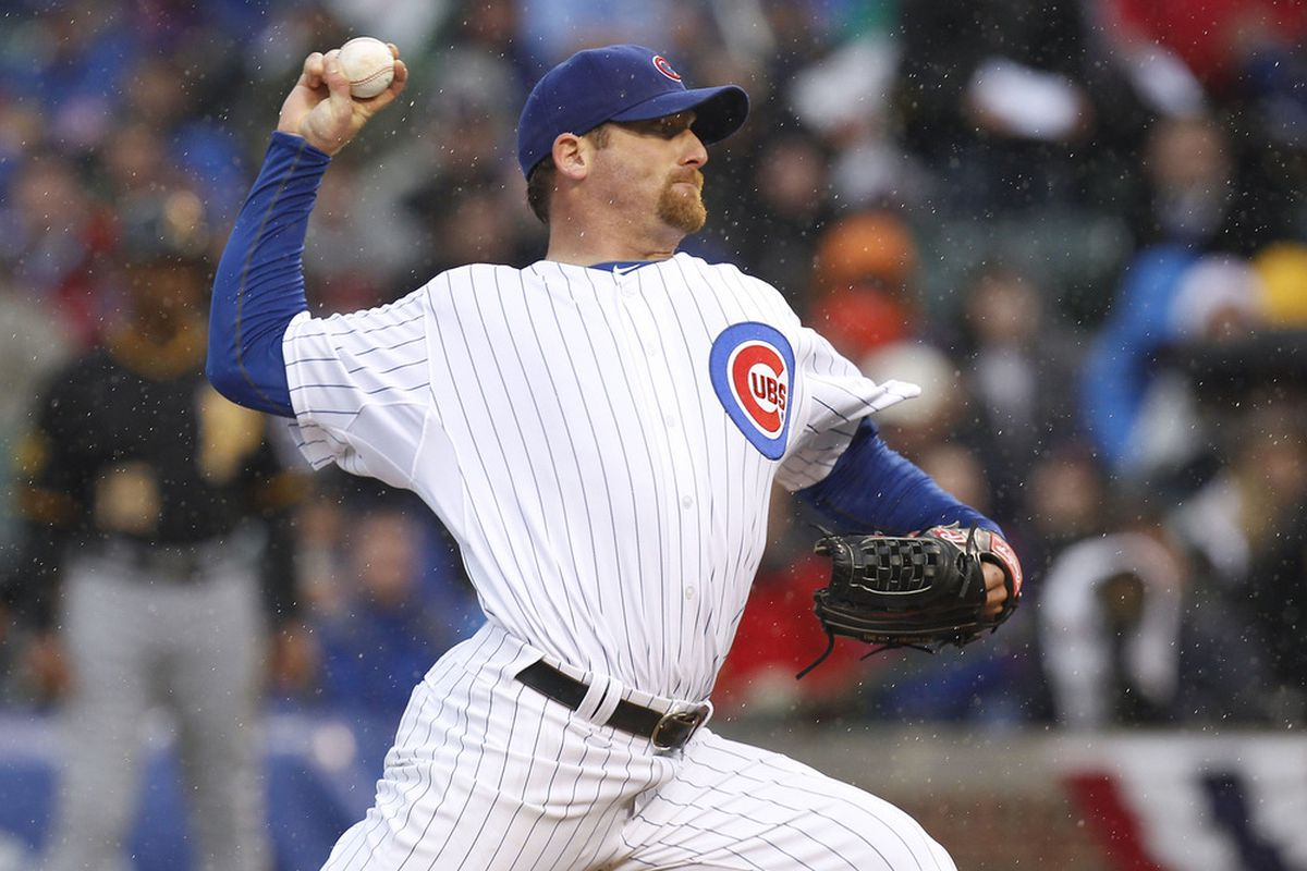 Ryan Dempster #36 of the Chicago Cubs throws a first inning pitch in the rain while playing the Pittsburgh Pirates during opening day at Wrigley Field on April 1, 2011 in Chicago, Illinois.  (Photo by Gregory Shamus/Getty Images)