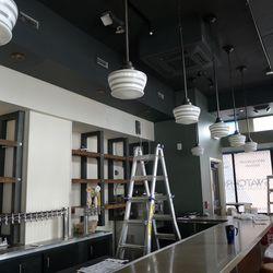 Schoolhouse lights hang over the bar.