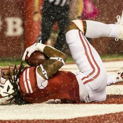 D'Cota Dixon holds on to make a diving interception.