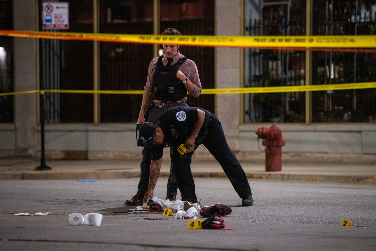 Chicago police investigate the scene where a man was shot in Rogers Park