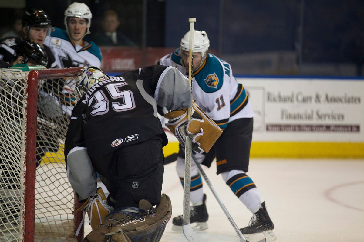 Manchester Monarchs goaltender Peter Mannino looks down at the puck after being beated by Worcester Sharks forward Jon Matsumoto late in the third period for what held up as the game winning goal Friday night at the DCU Center.