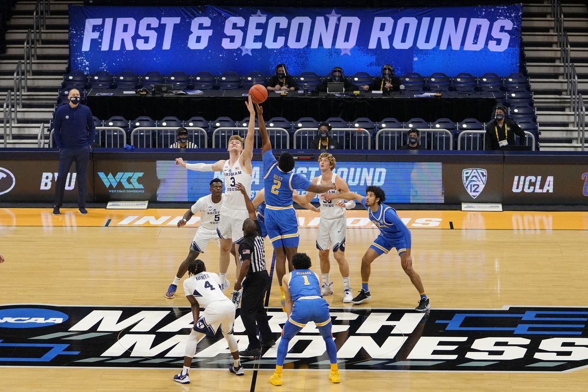BYU forward Matt Haarms goes up for the tipoff with UCLA forward Cody Riley during NCAA Tournament game at Hinkle Fieldhouse.