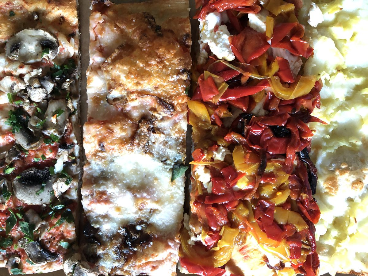 Four colorful slices of pizza from Bonci Pizzeria.