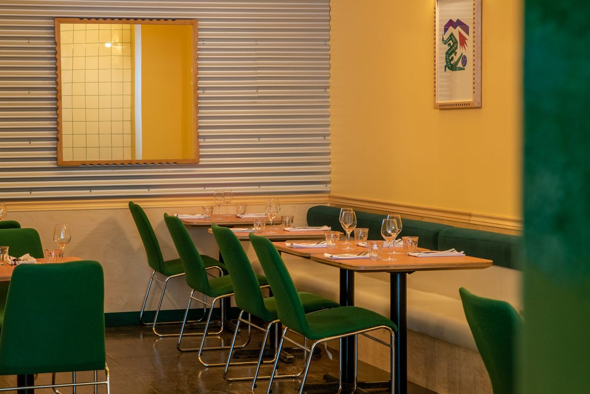 inside restaurant with green seating