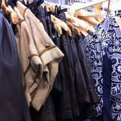 Part of the $99 deals - that camel dress peeking out of the racks were originally $495.