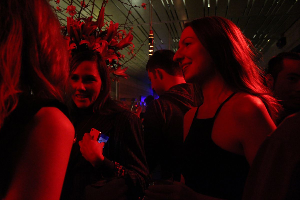 Two women talk during Product Hunt's last happy hour, which garnered 3,700 RSVPs.