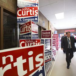 Posters and pop-ups line the hallway leading to the auditorium before the Republican convention at Timpview High School in Provo on Saturday, June 17, 2017.