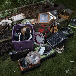 Kris Florczak, 70, salvages what she can from her home, including family photos and heirlooms, on Janes Avenue near Evergreen Lane in Woodridge after a tornado ripped through the western suburbs overnight, Monday morning, June 21, 2021.