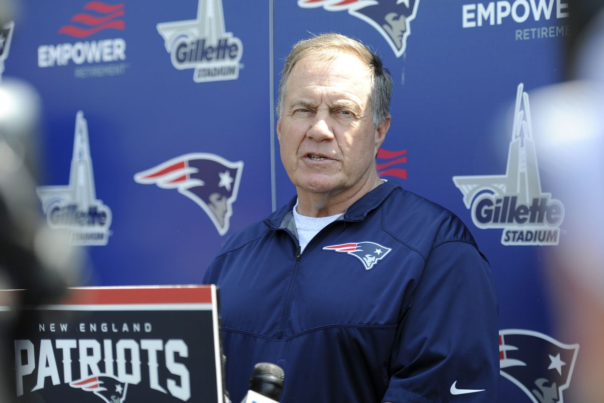 Patriots head coach Bill Belichick talks to the press