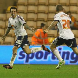 WOLVERHAMPTON, ENGLAND - OCTOBER 23: Mark Davies (L) of Bolton celebrates after scoring a late equalising goal during the npower Championship match between Wolverhampton Wanderers and Bolton Wanderers at Molineux on October 23, 2012 in Wolverhampton, Engl