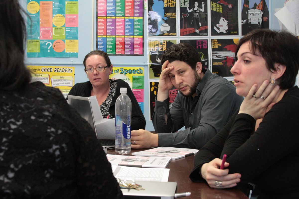 Brooklyn Generation School teachers Louise Bogue (left), Neil Garguilo and Kaylan Buendia (right) speak with Michele Hill, the school's college and career program director.