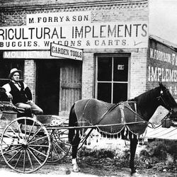 A farmer during the Utah territorial period stops at the local farm implements store in the 1890s.