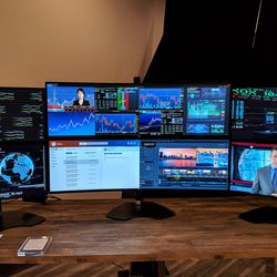 Two U4919DW monitors, flanked by smaller Dell QHD monitors.