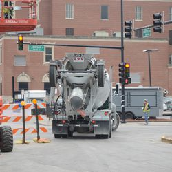 12:47 pm. View of concrete truck backing in on Sheffield from Addison -