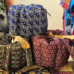 """<a href=""""http://www.abernadette.com/""""><b>A. Bernadette</b></a> was created by sisters <b>Andrea and Amberle Reyes</b>; together, they their line of eco-friendly, fair trade fashionable designs from Uganda to New York. Amberle showed us their African wax c"""